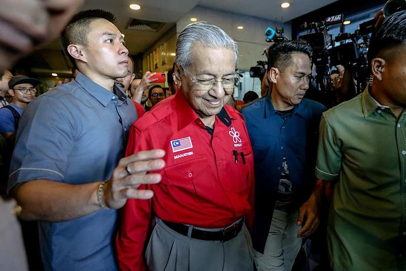 Bersatu chairman Tun Dr Mahathir Mohamad (in red shirt) leaves PBBM headquarters in Petaling Jaya February 23, 2020. — Picture by Firdaus Latif