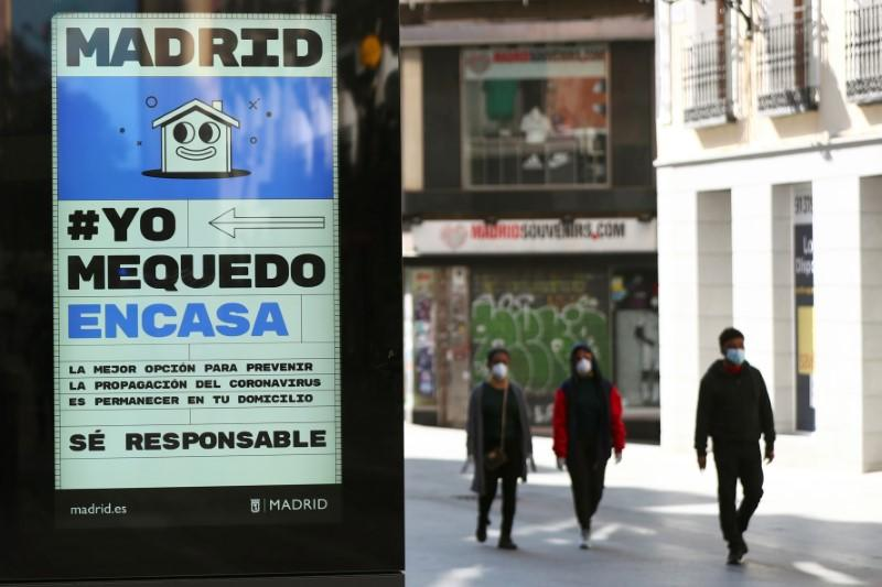 FILE PHOTO: FILE PHOTO: Ad advising people to be responsible and stay home is displayed in central Madrid