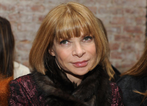 """FILE - This Friday, Feb. 12, 2010 photo shows Vogue Editor-in-Chief Anna Wintour before the start of the Rag & Bone fall 2010 collection during Fashion Week in New York. Conde Nast is expanding Vogue editor-in-chief Anna Wintour's role. She has been named the company's artistic director. The appointment was announced Wednesday, March 13, 2013 by CEO Charles H. Townsend. Her new duties include developing an overall """"creative vision"""" for Conde Nast, which has a portfolio of 18 consumer magazines including The New Yorker, Vanity Fair, Glamour, Allure and GQ. (AP Photo/Diane Bondareff, file)"""