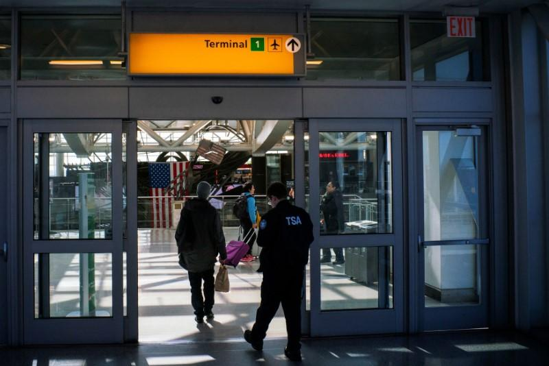 People arrive to terminal one at JFK airport after the Federal Aviation Administration (FAA) temporarily halted flights arriving at New York City airports due to coronavirus disease (COVID-19) in New York