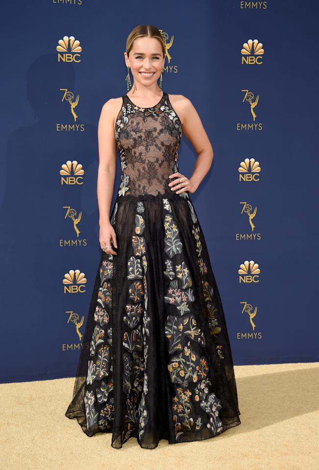 <p>Game Of Thrones star Emilia Clarke glows in a floral gown with a sheer-style bodice. <br />Photo: Getty </p>