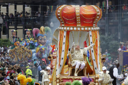 FILE - In this March 8, 2011 file photo, Rex, the King of Carnival rides in the Krewe of Rex as he arrives at Canal St. on Mardi Gras day in New Orleans. The Carnival season culminates on Tuesday, Feb. 12, 2013, with street revelry and the pageantry of the Rex and Zulu parades. (AP Photo/Gerald Herbert, file)