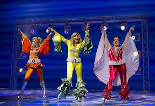 "This theater publicity image released by Boneau/Bryan-Brown shows, from left, Felicia Finley, Judy McLane and Lauren Cohn during a performance of the musical ""Mamma Mia!,"" at the Winter Garden Theatre in New York. Producers said Thursday, April 18, 2013, that the show featuring sings by ABBA will leave the Winter Garden Theatre and move to the Broadhurst Theatre some six blocks away. (AP Photo/Boneau/Bryan-Brown, Joan Marcus)"