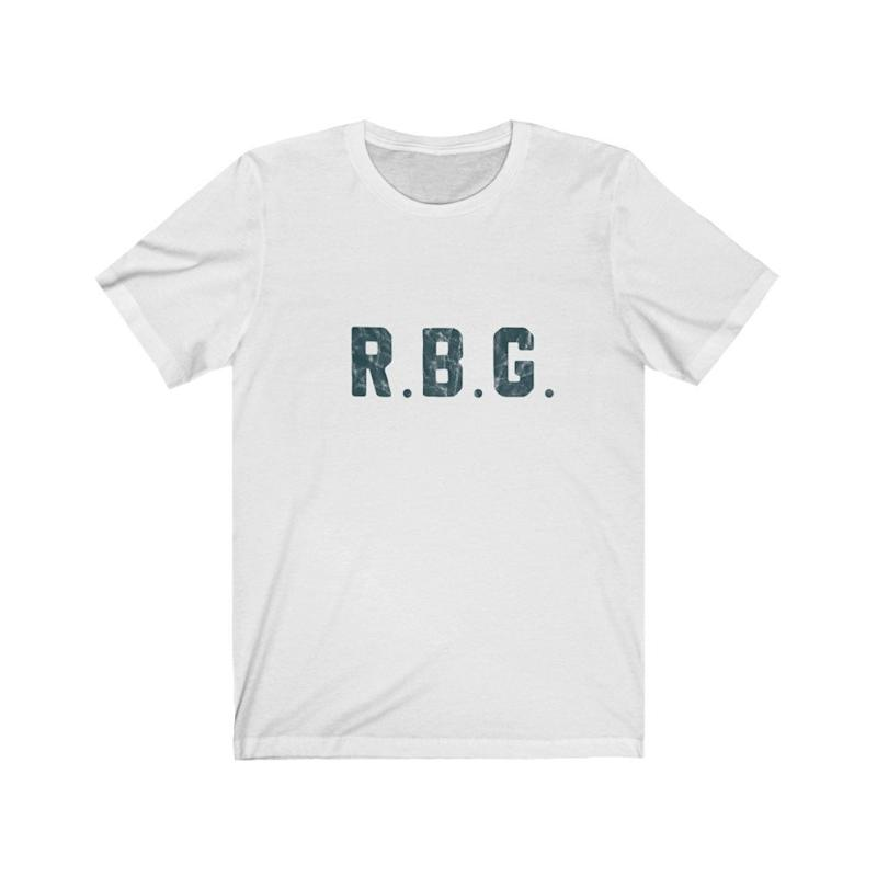 Ruth Bader Ginsburg t-shirt with retro distressed design and turquoise font. (Image via Etsy)