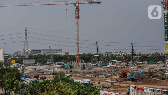 Suasana proyek pembangunan Jakarta International Stadium (JIS) atau Stadion BMW di kawasan Papanggo, Tanjung Priok, Jakarta, Senin (2/12/2019). Pembangunan proyek Stadion BMW telah mencapai tahap pemasangan tiang pancang di struktur bawah dengan persentase 7,1 persen. (Liputan6.com/Faizal Fanani)
