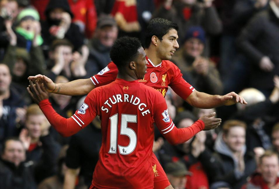 Liverpool's Suarez celebrates with teammate Sturridge after scoring a goal against Fulham during their English Premier League soccer match at Anfield in Liverpool