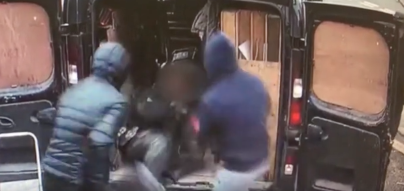 Two men are caught on CCTV pushing their victim into a van in England. Source: Humberside Police