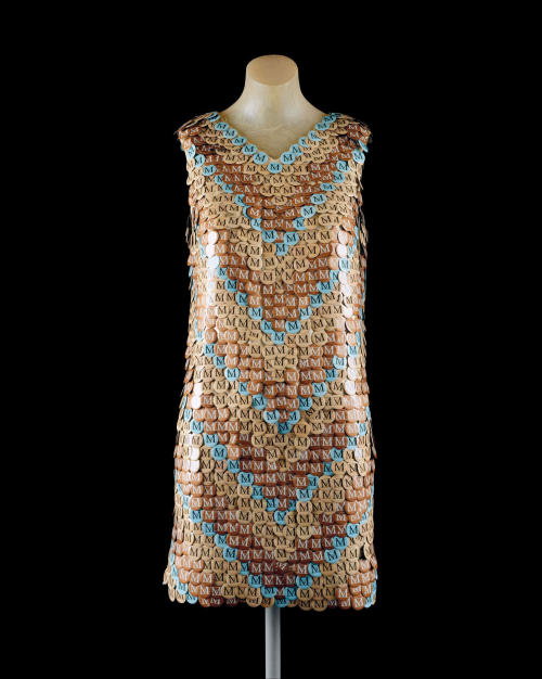 "This undated photograph provided by the Metropolitan Museum of Art shows ""Dress"", made of the museum's admission buttons by Ji Eon Kang, a gift to the museum by Richard Martin. Starting Monday, June 30, 2013, the button will be replaced with a paper ticket with detachable sticker. Museum officials say it has become too expensive to produce the buttons. They were introduced in 1971. The buttons came in 16 different colors and featured the letter ""M."" The color was changed daily. The change comes around the time the Met is switching to a seven-day week. It has been closed Mondays. (AP Photo/Metropolitan Museum of Art)"