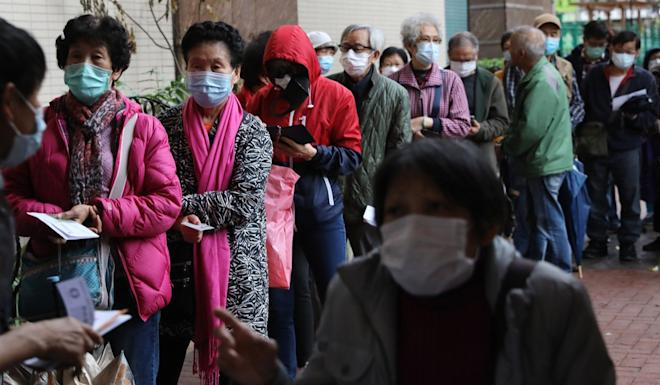 Elderly citizens queue up to get free surgical masks in Yau Ma Tei on February 13. Photo: Sam Tsang