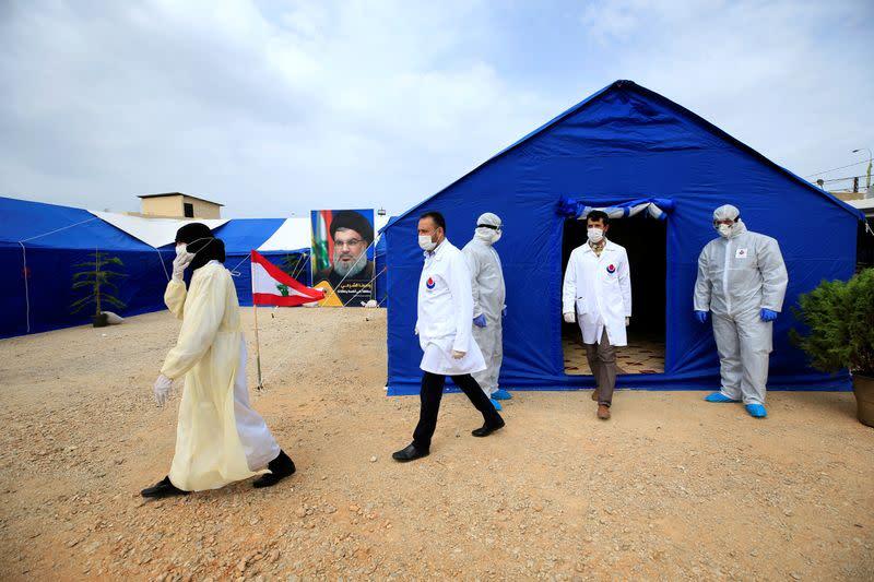 Medics walk outside tent facilities in al-Ghaziyeh