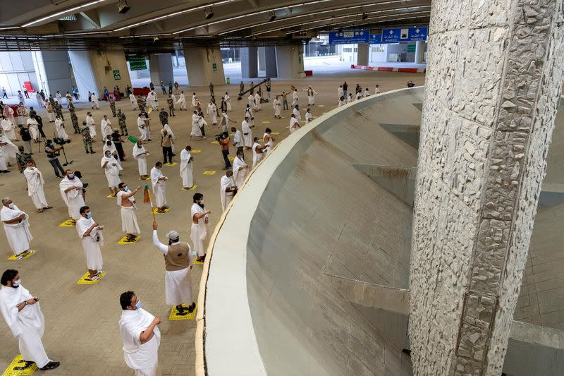 Haj pilgrims keep distance at usually crowded stone the devil ritual