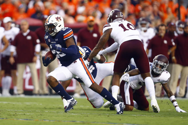 Auburn running back JaTarvious Whitlow, left, breaks loose for a touchdown during the first half of an NCAA college football game against Mississippi State, Saturday, Sept. 28, 2019, in Auburn, Ala. (AP Photo/Butch Dill)