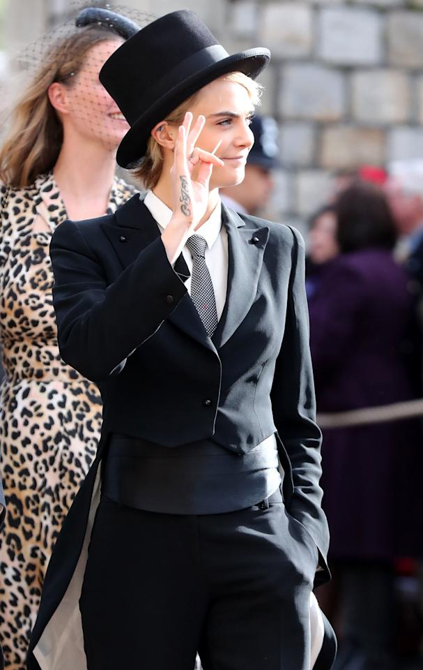 <p>Cara Delevingne looked spectacular in a three-piece morning suit and top hat, which is the dress code required of male guests. Photo: Getty </p>