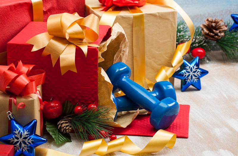 Christmas gifts with blue sport dumbbells and blue star toys for .the Christmas tree