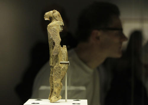 A mammoth ivory sculpture depicts a man with a lion's head, discovered at Stadel Cave, Baden-Wurttemberg, Germany, dates to around 40,000 years ago is seen on display in an exhibition 'Ice Age Art : arrival of the modern mind' at the British Museum in London, Tuesday, Feb. 5, 2013. The exhibition present masterpieces create from the last Ice Age between 40,000 and 10,000 years ago, drawn from across Europe, by artists with modern minds and presented alongside modern works to illustrate the fundamental human desire to communicate and make art as a way of understanding ourselves and our place in the world. (AP Photo/Sang Tan)