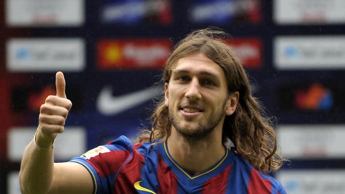 Dmytro Chygrynskiy – Transfer ke Barcelona membuatnya menjadi pemain Ukraina pertama yang bermain untuk Barcelona. Biaya 25 juta euro ditebus demi mendapatkan pemain gondrong tersebut, (AFP/Lluis Gene)