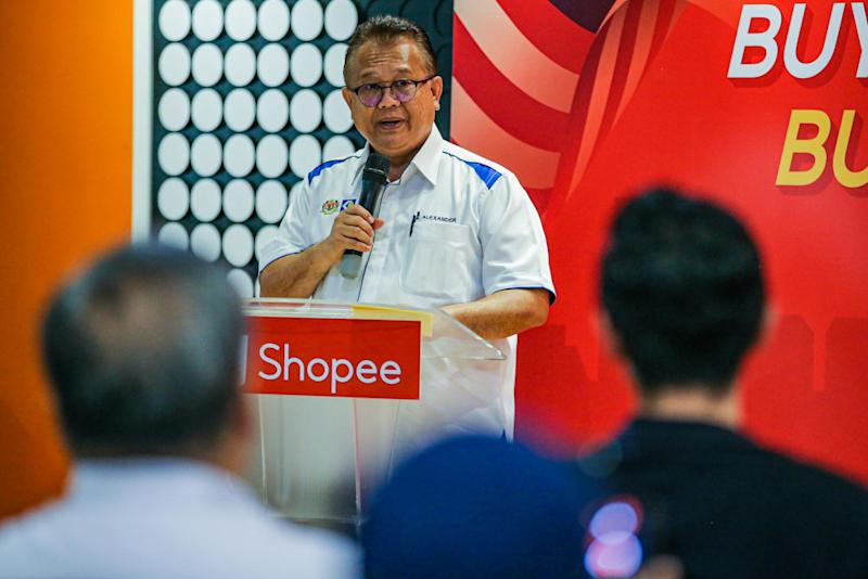 Alexander says the partnership with Shopee will help drive the nation's economy forward. — Picture by Hari Anggara