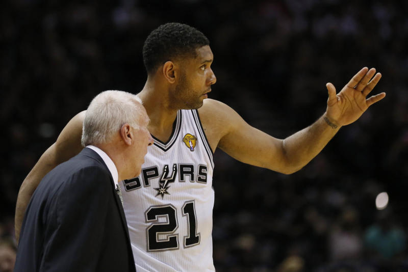 Jun 5, 2014; San Antonio, TX, USA; San Antonio Spurs forward Tim Duncan (21) talks to San Antonio Spurs head coach Gregg Popovich during the first quarter against the Miami Heat in game one of the 2014 NBA Finals at AT&T Center. Mandatory Credit: Soobum Im-USA TODAY Sports