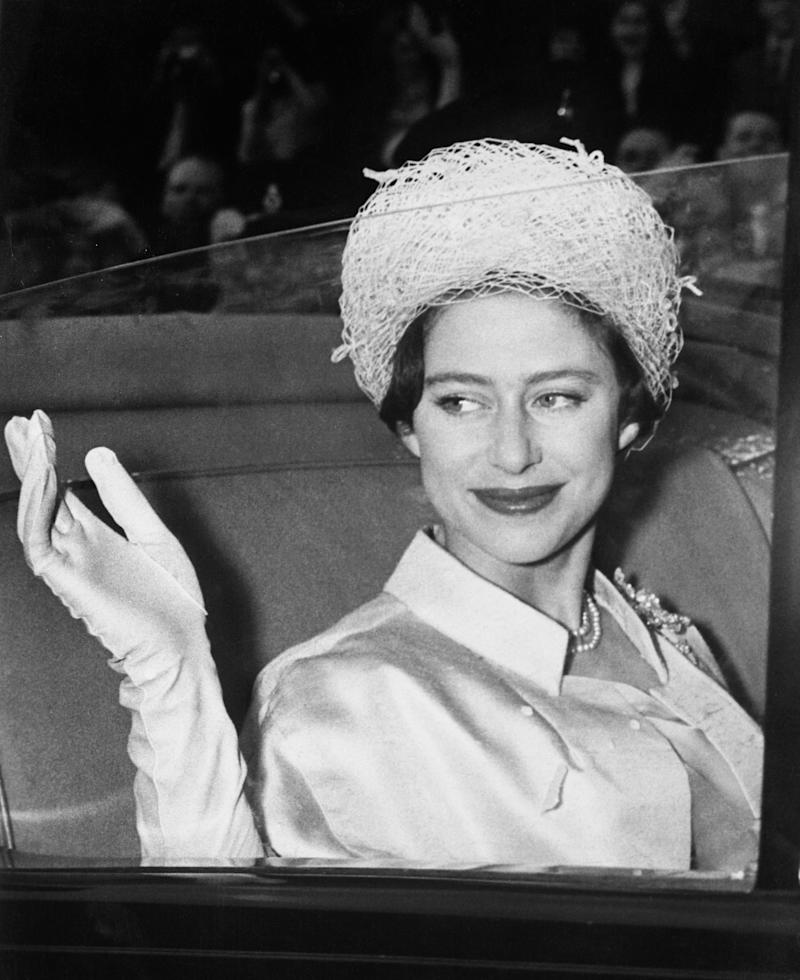 The Queen's sister Princess Margaret waves from a car in the 1950s.