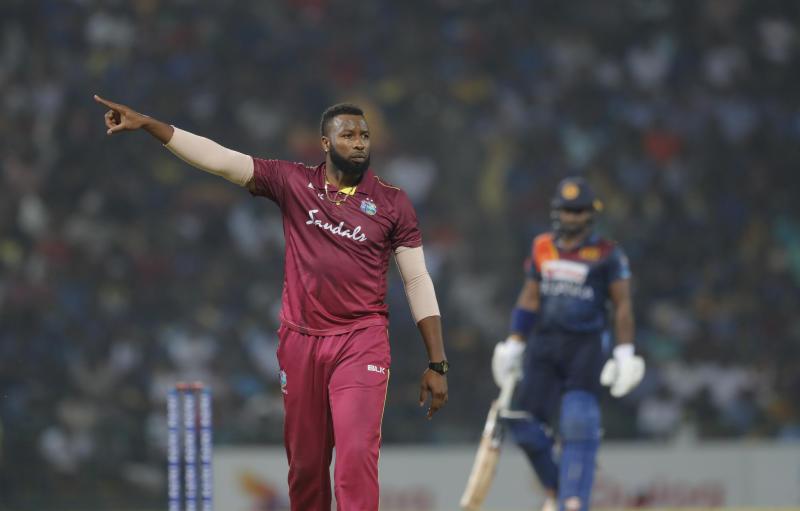 West Indies' captain Kieron Pollard gestures as he sets the field during the first Twenty20 cricket match with Sri Lanka in Pallekele, Sri Lanka, Wednesday, March 4, 2020. (AP Photo/Eranga Jayawardena)