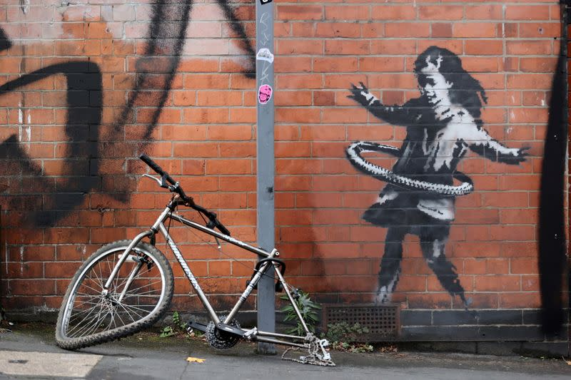 British artist Banksy claims hula-hooping girl street art