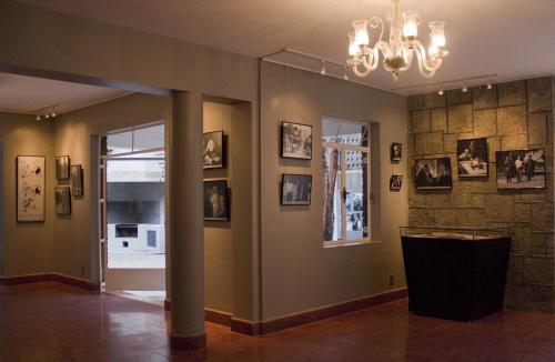 "In this Aug. 1, 2013 photo, photographs about the life and films of Luis Bunuel hang at the ""Casa Bunuel"" in Mexico City. Critics still regard Bunuel as one of cinema's greatest directors with movies such as ""L'Age d'Or"" and ""That Obscure Object of Desire"" pushing the boundaries of both taste and narrative. (AP Photo/Gabriela Sanchez)"