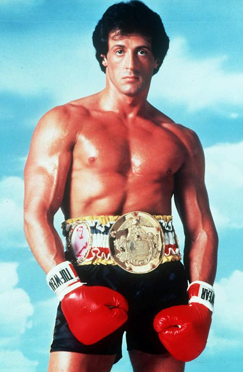 """This undated publicity image originally released by United Artists shows Sylvester Stallone posing in character as Rocky Balboa in the boxing film, """"Rocky."""" It's been a knock-out in Germany. Now Stallone hopes a musical based on his beloved boxing film """"Rocky"""" will also be a hit on Broadway. Producers say they hope to get """"Rocky"""" up and punching at the Winter Garden by February following a successful debut in Hamburg last fall. Based on the Oscar-winning 1976 film, the musical features a score by """"Ragtime"""" veterans Stephen Flaherty and Lynn Ahrens, and a story by Thomas Meehan, who wrote """"The Producers"""" and """"Hairspray."""" (AP Photo/United Artists)"""