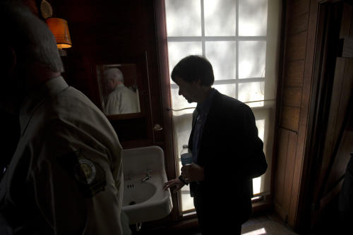Documentary filmmaker Ken Burns, right, walks through the bathroom at the Georgia home used by former President Franklin D. Roosevelt, Saturday, Nov. 2, 2013, in Warm Springs, Ga. Burns along with several members of the Roosevelt family toured the home known as the Little White House Saturday used by Roosevelt as Burns previewed parts of his 14-hour film on the Roosevelt's. (AP Photo/David Goldman)