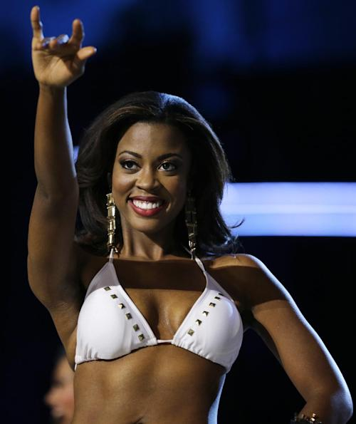 Miss Texas Ivana Hall gestures the longhorns with her fingers during the Miss America 2014 pageant, Sunday, Sept. 15, 2013, in Atlantic City, N.J. (AP Photo/Mel Evans)