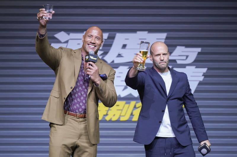 BEIJING, CHINA - AUGUST 05: Actors Jason Statham (R) and Dwayne Johnson attend the 'Fast & Furious: Hobbs & Shaw' press conference on August 5, 2019 in Beijing, China. (Photo by Visual China Group via Getty Images/Visual China Group via Getty Images)