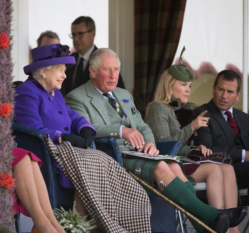 The Queen and Prince Charles were joined by Princess Anne's son and daughter-in-law Peter and Autumn Philips at the Highland Games in Braemar, Scotland. Photo: Getty Images