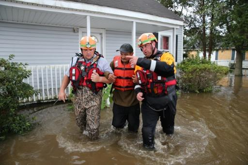 The effects of climate change, such as the flooding seen in North Carolina during Hurricane Florence in September 2018, will get worse unless more drastic action is taken to cut carbon emissions, a major US government report warned