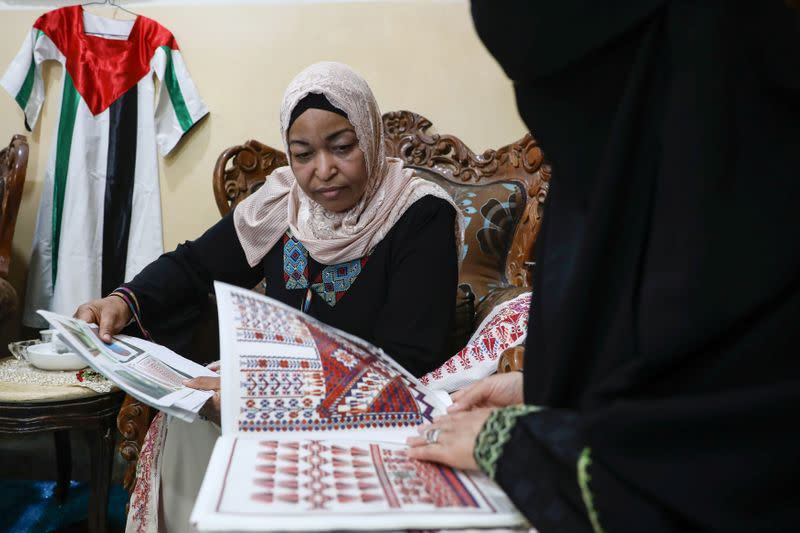 Um Zeid, 47 year-old, and Khawla 48 year-old, Palestinian refugees women living in Jordan embroider a traditional Palestinian dresses for customers at Al-Baqaa Palestinian refugee camp, near Amman