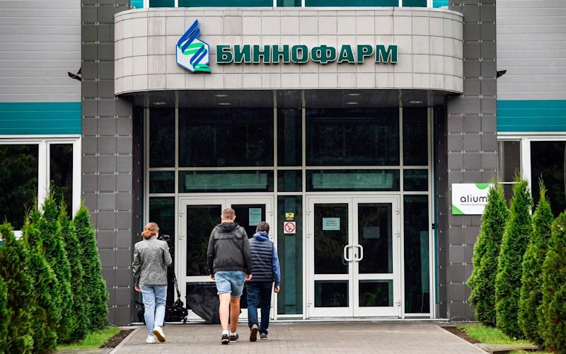 Scientists at the pharmaceutical factory Binnofarm have begun producing the vaccine but there is international scepticism about its efficacy - ALEXANDER NEMENOV/AFP