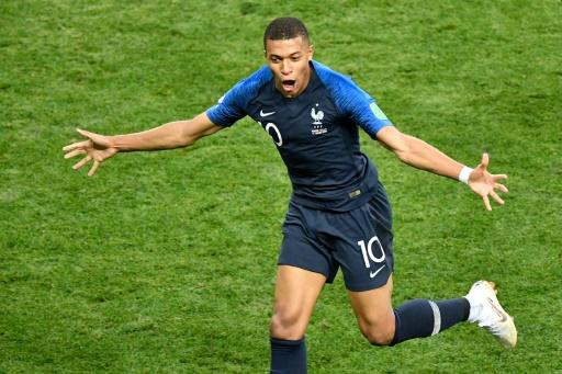 Golden boy: Kylian Mbappe celebrates his fourth goal of the tournament