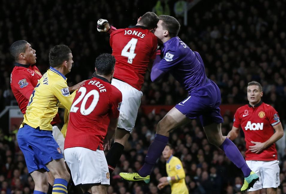 Manchester United's Jones clashes heads with Arsenal's Szczesny during their English Premier League soccer match in Manchester