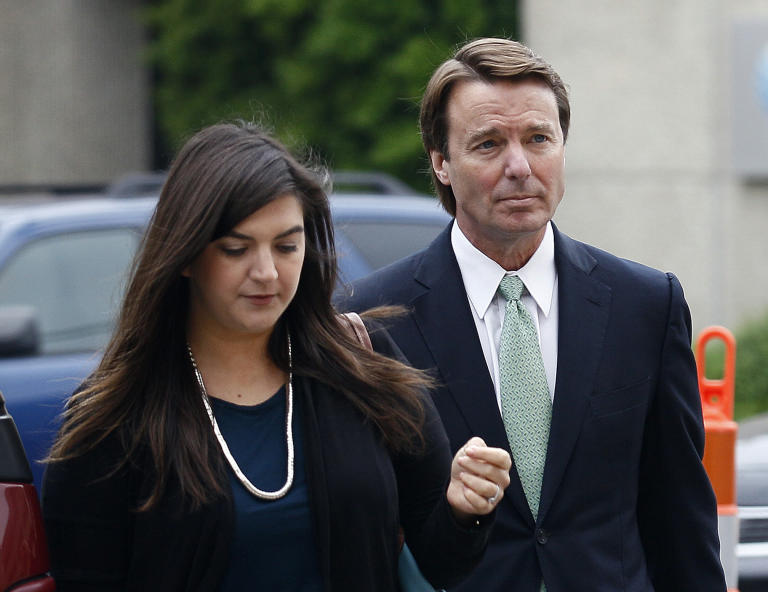Former presidential candidate and Sen. John Edwards and his daughter, Cate Edwards, arrive at a federal courthouse in Greensboro, N.C., Wednesday, May 9, 2012. Edwards is accused of conspiring to secretly obtain more than $900,000 from two wealthy supporters to hide his extramarital affair with Rielle Hunter, as well as her pregnancy. He has pleaded not guilty to six charges related to violations of campaign finance laws. (AP Photo/Gerry Broome)