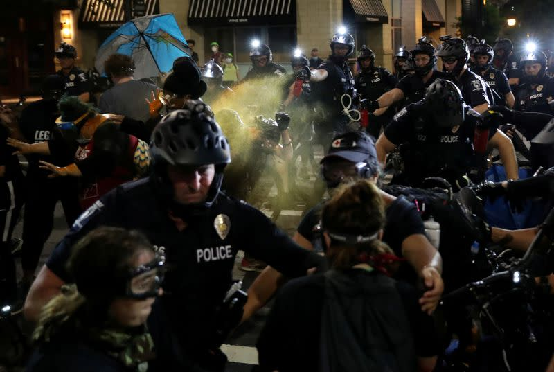 Protesters scuffle with police in Charlotte ahead of Republican convention