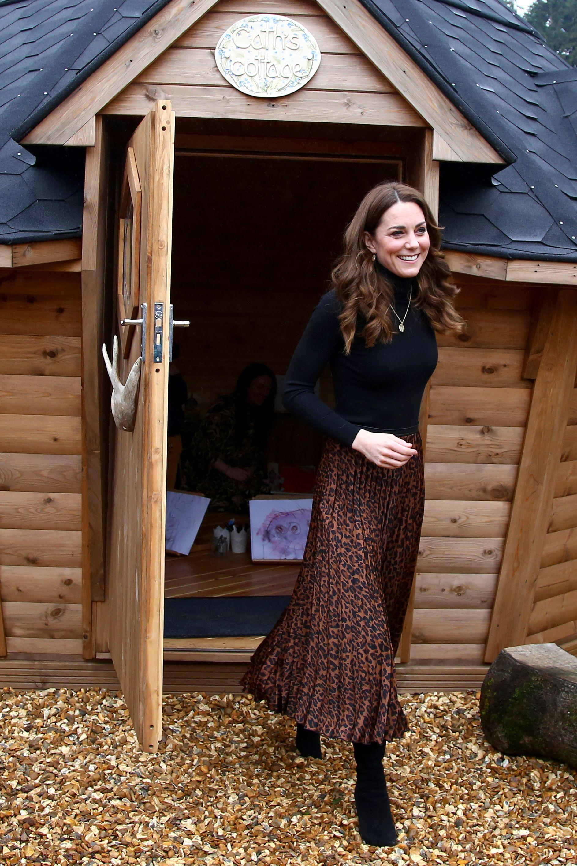 Once inside the centre Kate showed off the leopard print skirt, which she paired with a black jumper. [Photo: Getty]
