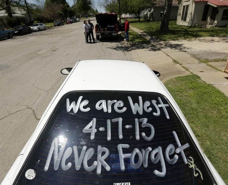 A sign is seen on a car window as residents wait to enter a damaged neighborhood Saturday, April 20, 2013, three days after an explosion at a fertilizer plant in West, Texas. The massive explosion at the West Fertilizer Co. Wednesday night killed 14 people and injured more than 160. (AP Photo/Charlie Riedel)