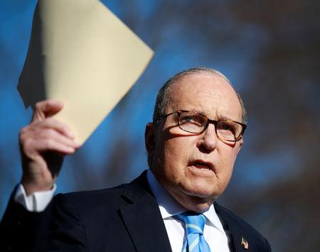 FILE PHOTO:  White House economic adviser Larry Kudlow speaks to the media outside the White House in Washington, U.S., December 3, 2018.  REUTERS/Jim Young
