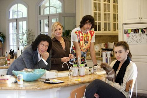 "This undated image released by A&E shows, from left, Gene Simmons, Shannon Tweed, Nick Simmons and Sophie Simmons in the A&E reality series, ""Gene Simmons Family Jewels."" A&E and and KISS guitarist Gene Simmons said that the ""Gene Simmons Family Jewels"" reality show is ending after seven seasons. Simmons said that with KISS on tour and his other business commitments, he and his family have decided to move on from the show. It depicted his out-of-makeup life with his colorful family. A&E said it thanked Simmons and his family for opening up their lives, warts and all. (AP Photo/A&E, Richard Knapp)"