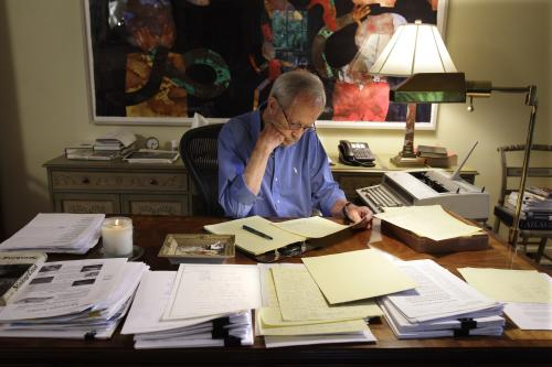 FILE - In this Tuesday, Sept. 28, 2010 file photo, author Elmore Leonard works on a manuscript at his home in Bloomfield Township, Mich. Leonard, a former adman who later in life became one of America's foremost crime writers, has died. He was 87. His researcher says he passed away Tuesday morning, Aug. 20, 2013 from complications from a stroke. (AP Photo/Carlos Osorio)