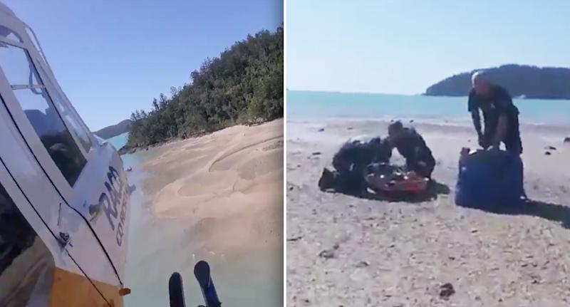 The RACQ CQ chopper touches down on Cid Harbour in Whitsunday Islands off the Queensland state coast after a 12-year-old girl was attacked by a shark.