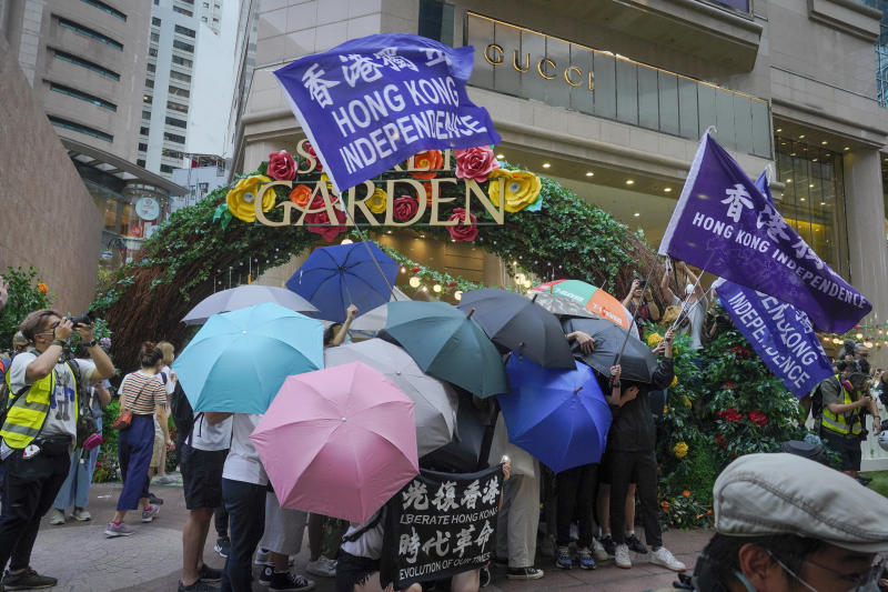 Protesters set up a defense shield using umbrellas and wave Hong Kong Independence flags on a road during against the new national security law march of Hong Kong's handover to China from Britain in Hong Kong, Wednesday, July. 1, 2020. Hong Kong marked the 23rd anniversary of its handover to China in 1997, and just one day after China enacted a national security law that cracks down on protests in the territory. (AP Photo/Vincent Yu)