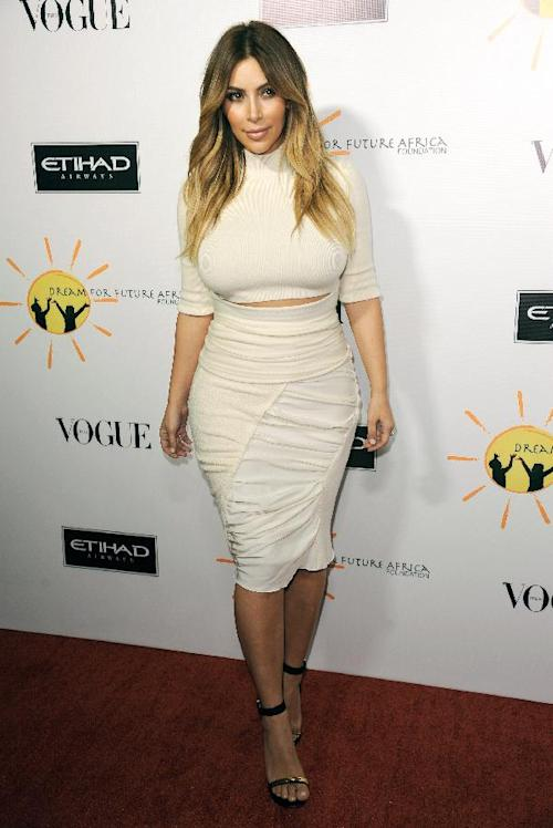 "FILE - This Oct. 24, 2013 file photo shows TV personality Kim Kardashian at the inaugural Dream for Future Africa Foundation Gala in Beverly Hills, Calif. Kanye West says when it comes to fashion, Kim Kardashian reigns supreme over every woman, including Michelle Obama. In an interview Tuesday with Ryan Seacrest, the rapper said he and his fiancé are ""the most influential with clothing."" (Photo by Richard Shotwell/Invision/AP, File)"