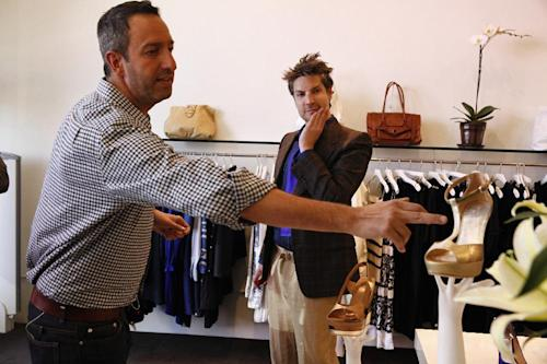 """In this undated photo provided by Bravo, Christos Garkinos, left, and Cameron Silver, owners of Los Angeles vintage store Decades, and hosts of the new reality TV show """"Dukes of Melrose,"""" talk about a pair of shoes in their store during one of the show's episodes. Silver and Garkinos hold many style secrets of fashion's royalty, and the duo dish some of them on the new Bravo series. (AP Photo/Bravo, Vivian Zink)"""