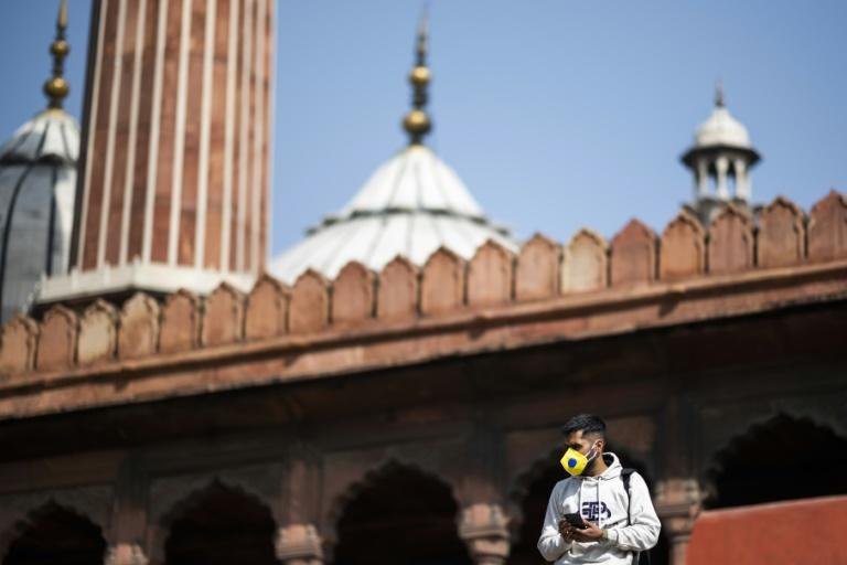 A man wears a facemask at the Jama Masjid Mosque in the old quarter of New Delhi on March 13