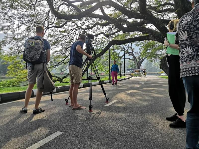 'Great Railway Journeys' host Micheal Portillo shooting a scene at Taiping Lake Gardens. — Picture via Facebook/ Majlis Perbandaran Taiping