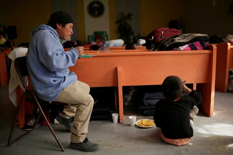 Migrants from Central America, sent back to Mexico to await their outcome of their cases under the Migrant Protection Protocols (MPP), eat at El Buen Pastor shelter in Ciudad Juarez
